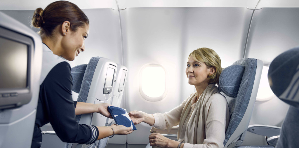 finnair-economy-comfort-longhaul-cabin-attendant-woman_low